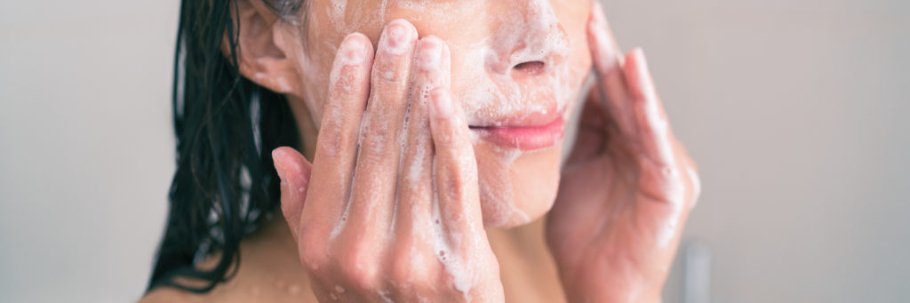 Woman gentle cleansing face